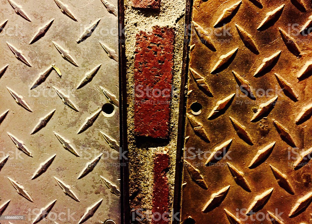 Abstract close up of city sidewak steel door royalty-free stock photo