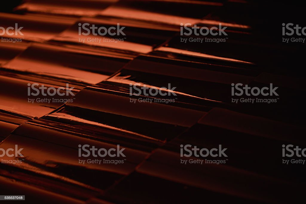 Abstract closeup metal profile roof-tile at sunset. stock photo