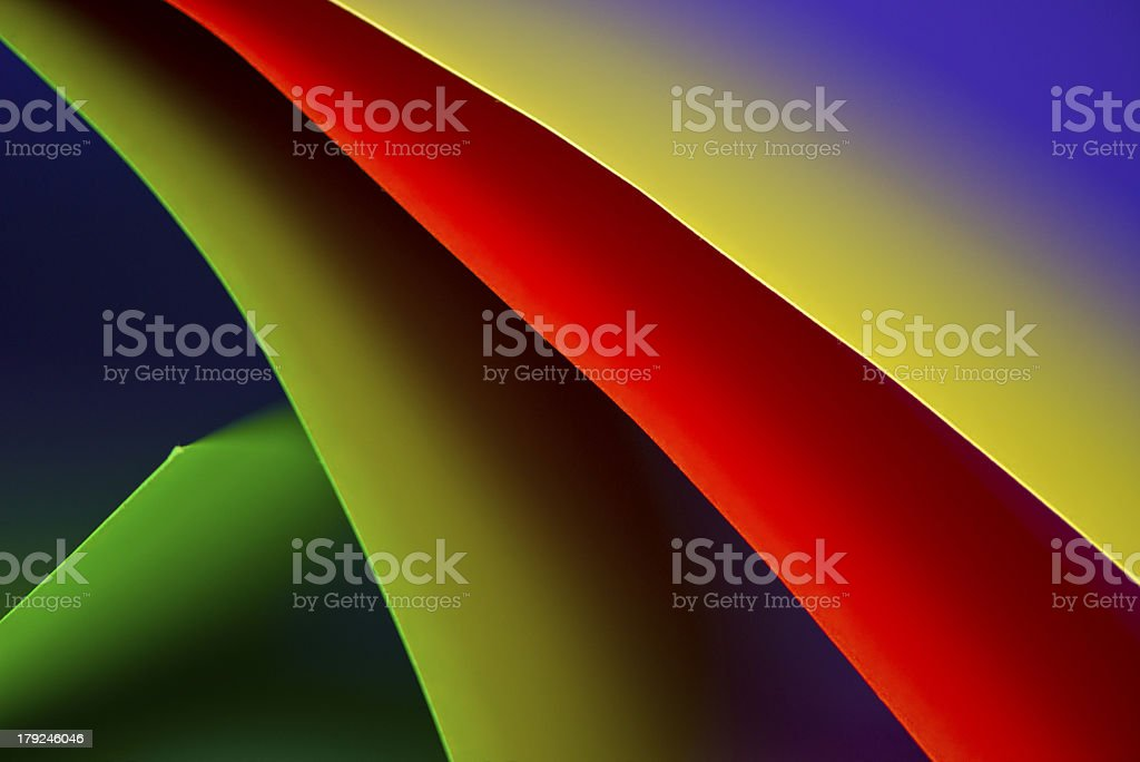 Abstract colored paper background stacked in curved shape royalty-free stock photo