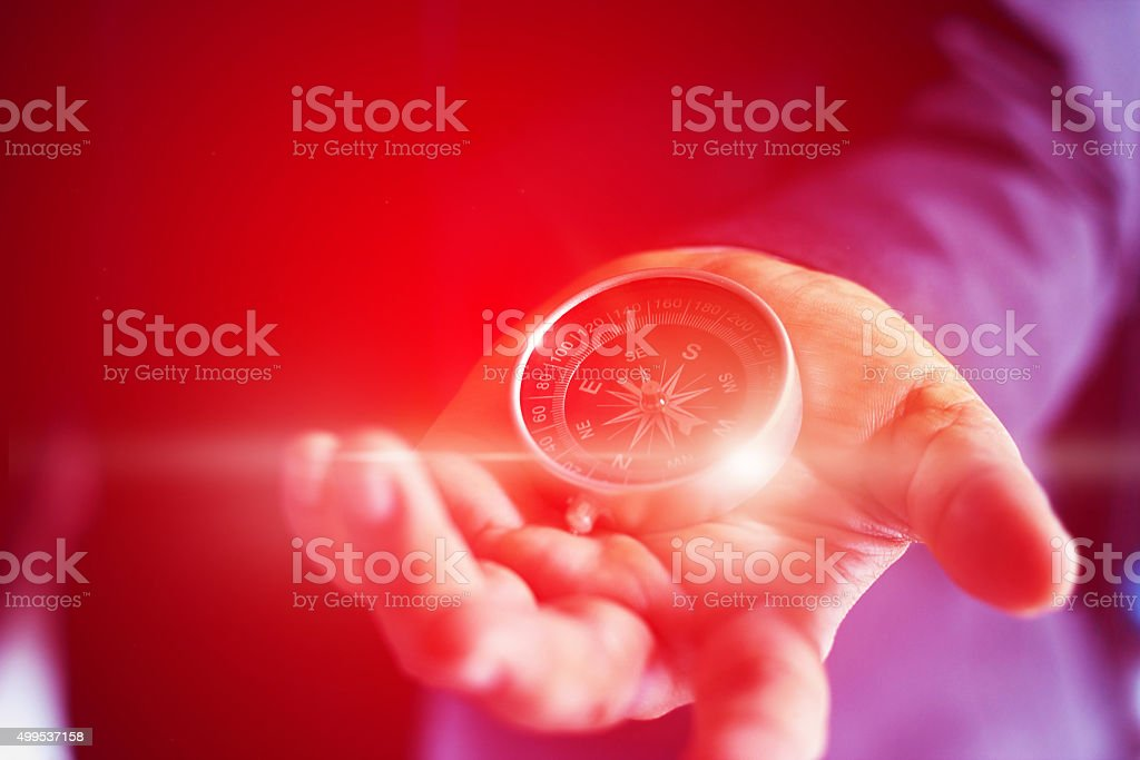 Abstract, colorful businessman with a compass holding in hand, s stock photo