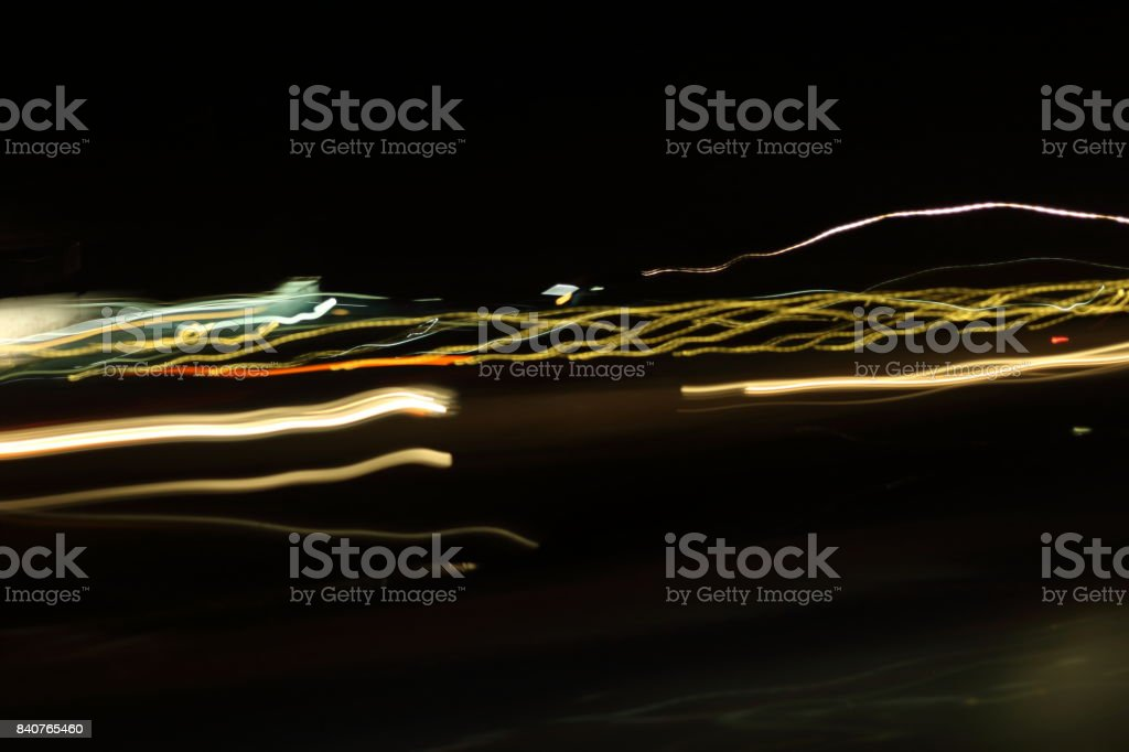 Abstract colorful light painting on dark background. Slow speed shutter stock photo