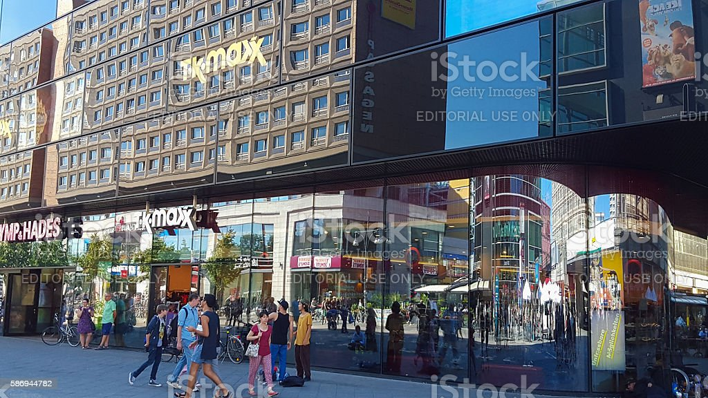 Abstract colorful mirroring of Berlin Alexanderplatz shops stock photo