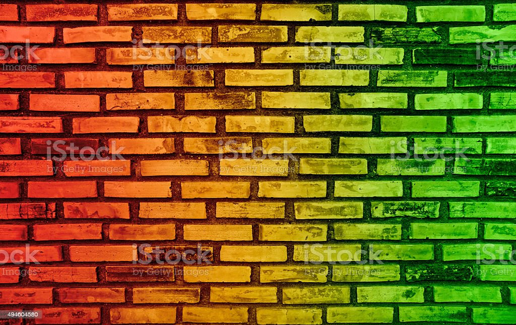 Abstract colors on brick wall background and reggae music stock photo