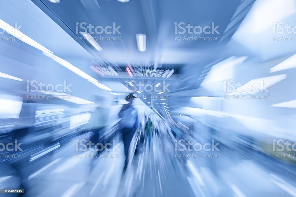 abstract commuters motion blurred at the airport stock photo