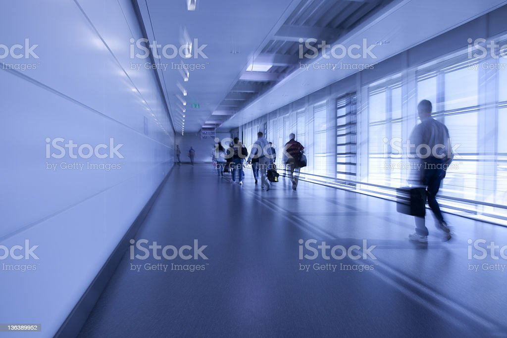 abstract commuters motion blurred at the airport royalty-free stock photo