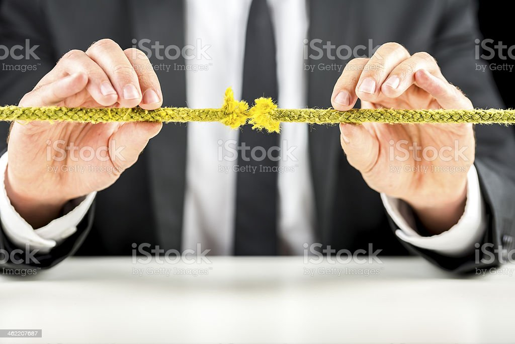 Abstract concept of risk represented by a frayed rope stock photo