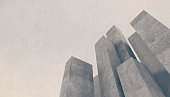 Abstract concrete city background with towering stone buildings