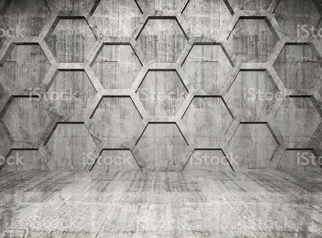 Abstract concrete interior with honeycomb structure on gray wall stock photo