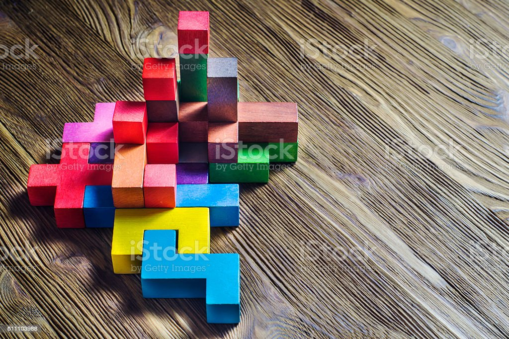 Abstract construction from wooden blocks tetris shapes. stock photo