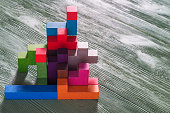 Abstract construction from wooden blocks tetris shapes.