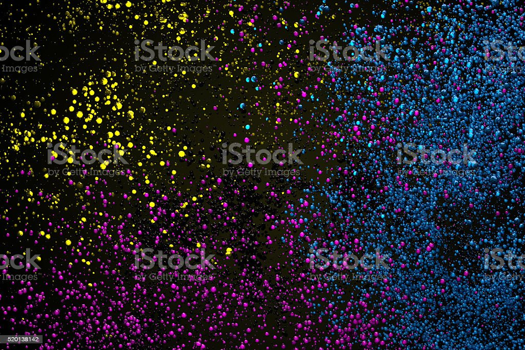 Abstract crazy background of many small crystals in CMYK colors. stock photo