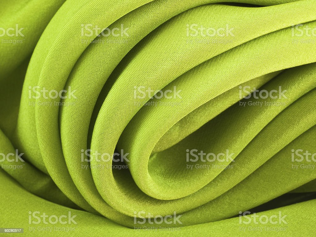 Abstract curved green silk fabric texture royalty-free stock photo