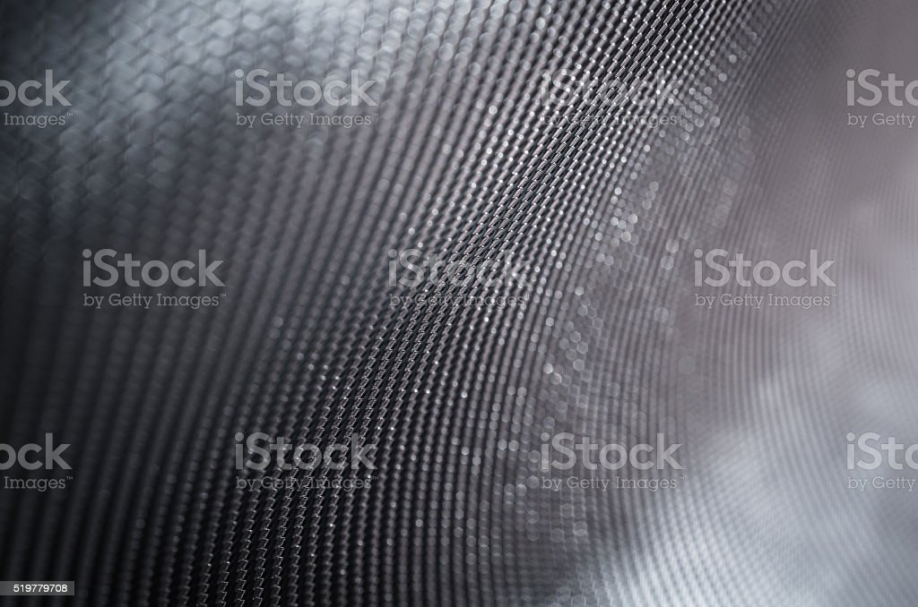Abstract dark backgroud shallow depth of field carbon fiber text stock photo
