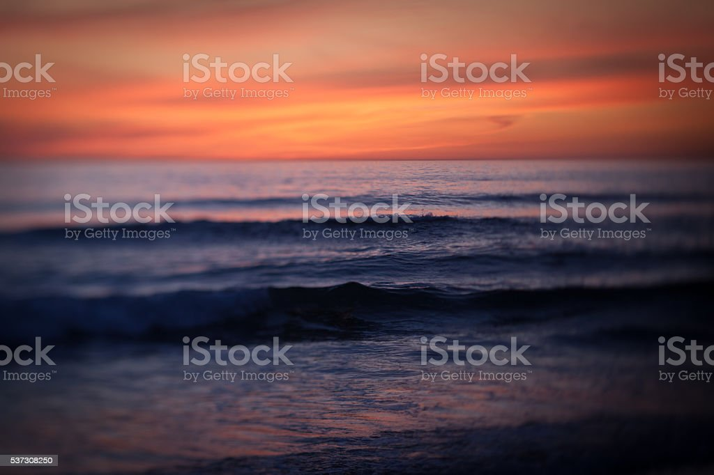 Abstract dark toned image of ocean and sunset stock photo