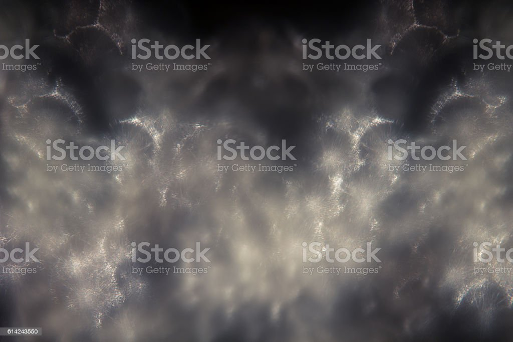 Abstract dark white flakes squama smoky background. stock photo