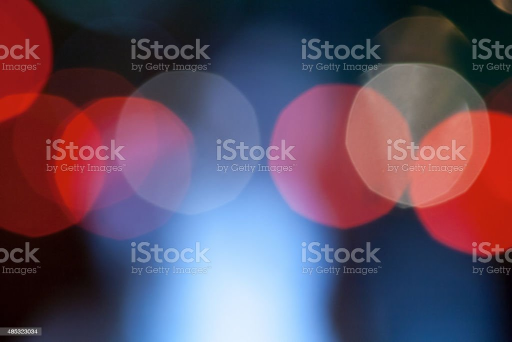 abstract defocused background. Big red xmas lights bokeh outdoors stock photo