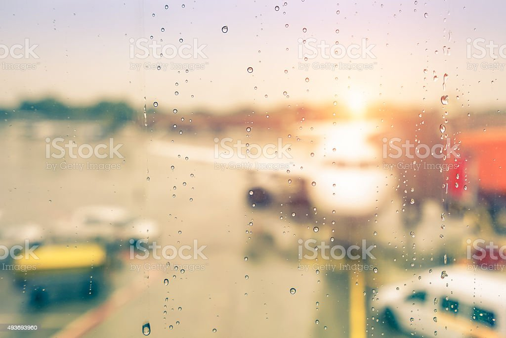 Abstract defocused bokeh of airplane at airport gate before sunset stock photo