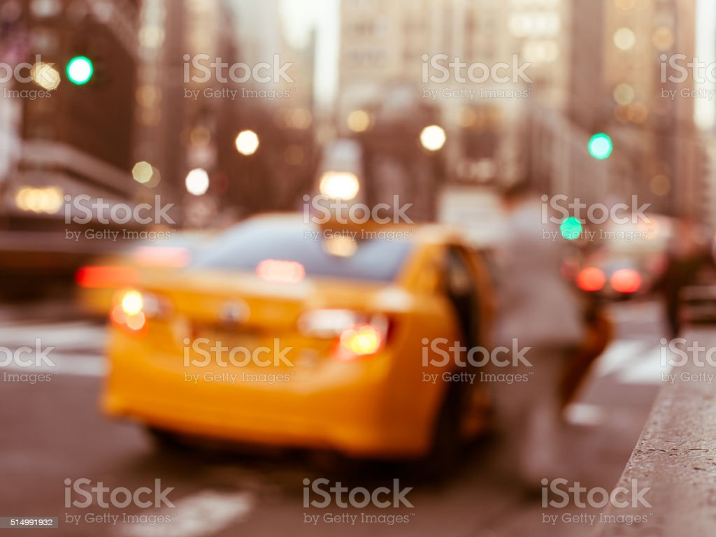 Abstract defocused businessman entering cab in New York City stock photo