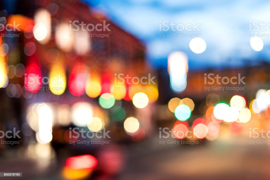 Abstract defocused city street scene at night stock photo