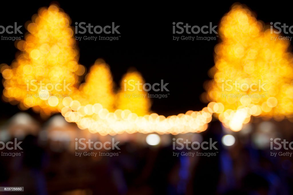 Abstract defocused Crowd people in amusement park with Lighting Tree scene at night stock photo