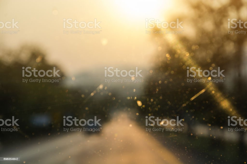 Abstract defocused of light on the mirror of car driving on road stock photo