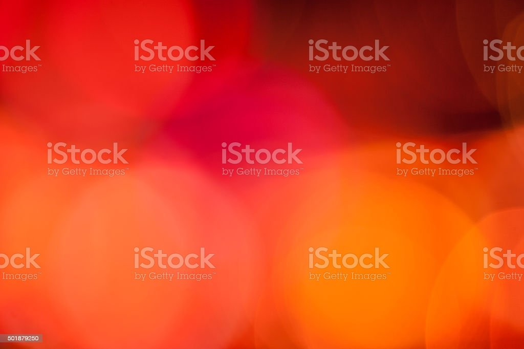 Abstract defocused orange and red circular light pattern stock photo