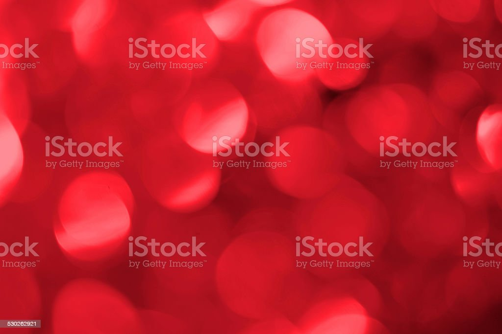 Abstract defocused red sparkles background stock photo