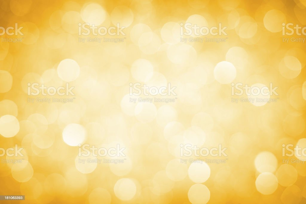 Abstract defocused yellow sparkles background royalty-free stock photo