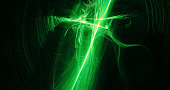 Abstract Design In Green And Yellow Lines Curves Particles
