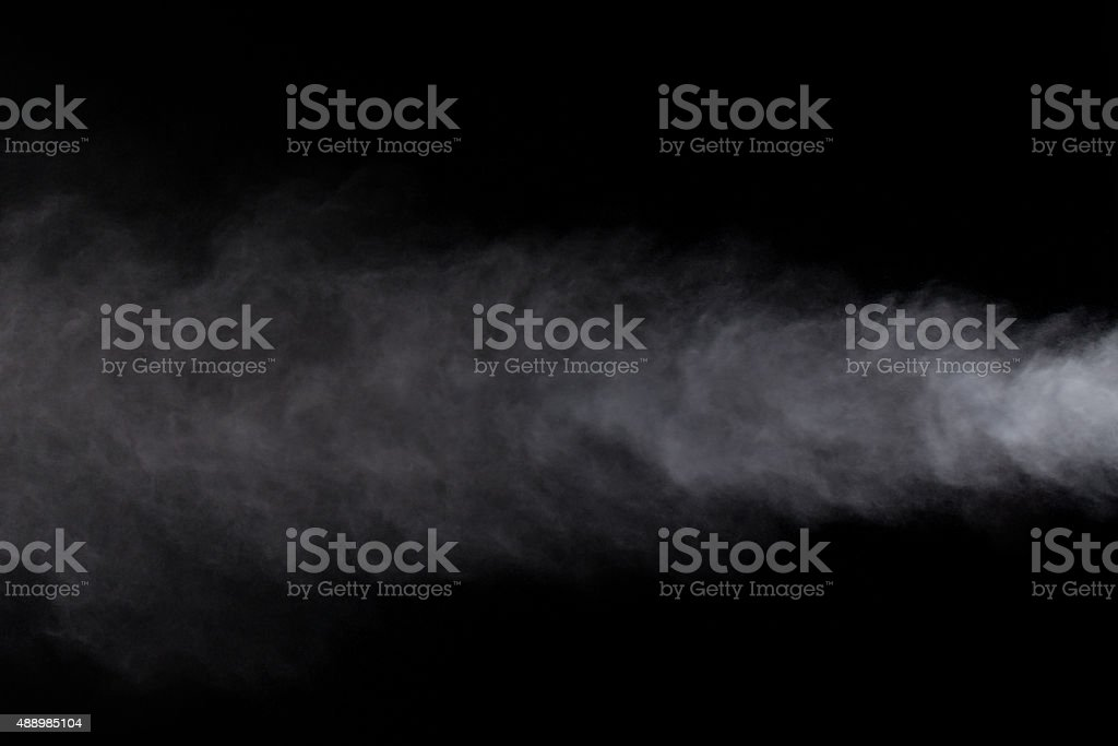 Abstract design of white powder cloud against dark background stock photo