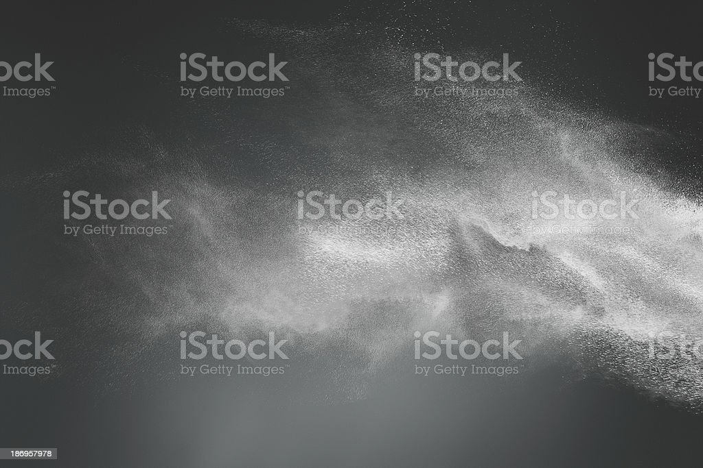 Abstract design of white powder cloud on dark background stock photo