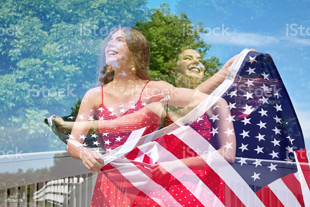Abstract double exposure of photos of woman waving American Flag stock photo