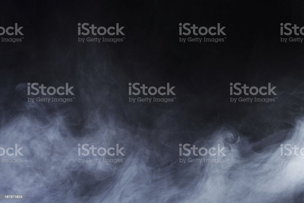 Abstract Ethereal Smoke Rising up from the Ground stock photo