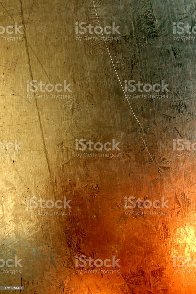 Abstract explosion-like reflections on a metal plate stock photo