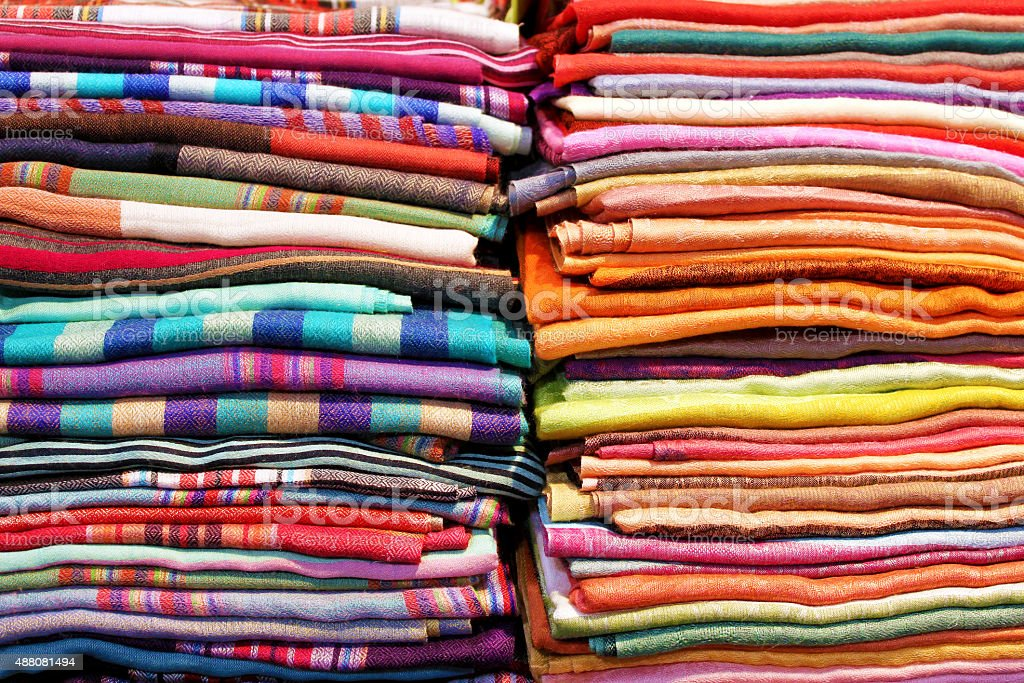 Abstract folded colorful fabrics and textile close up background stock photo