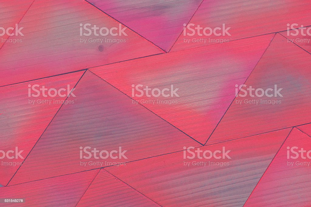 abstract geometric background of painted wood pieces. stock photo