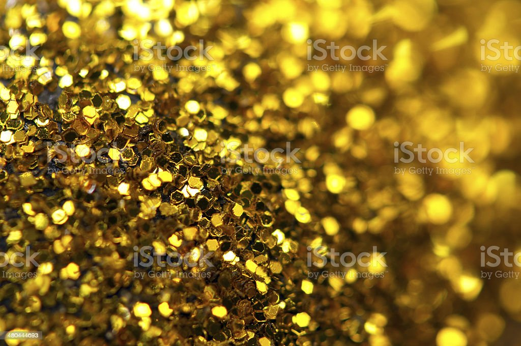 Abstract gold background. Macro stock photo