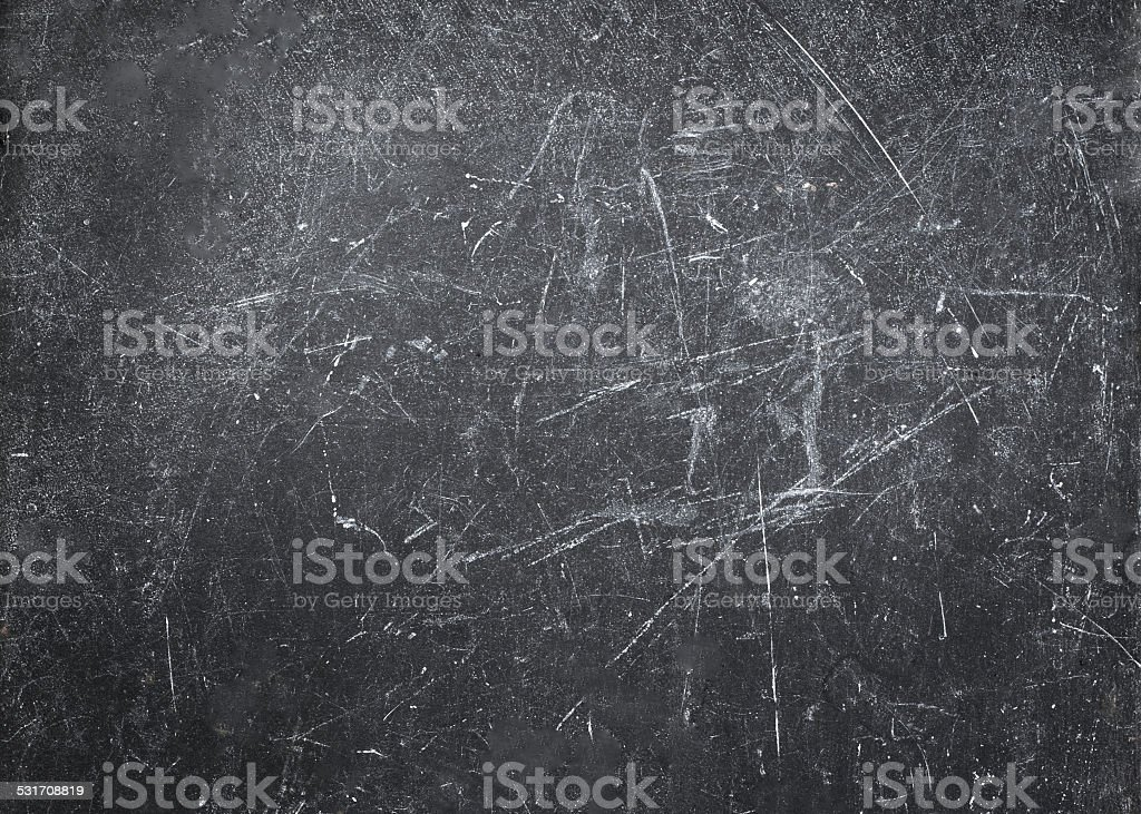 Abstract Gray  background with spotlight and scratches. Dark stock photo