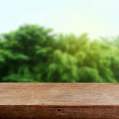 Abstract green background and wooden table