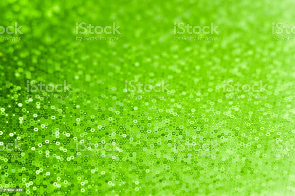 Abstract green batsground with small circles, for party invitation for birthday card, St Patrick's Day poster, wedding design or Christmas texture. Background is blurry, with a selective focus. stock photo