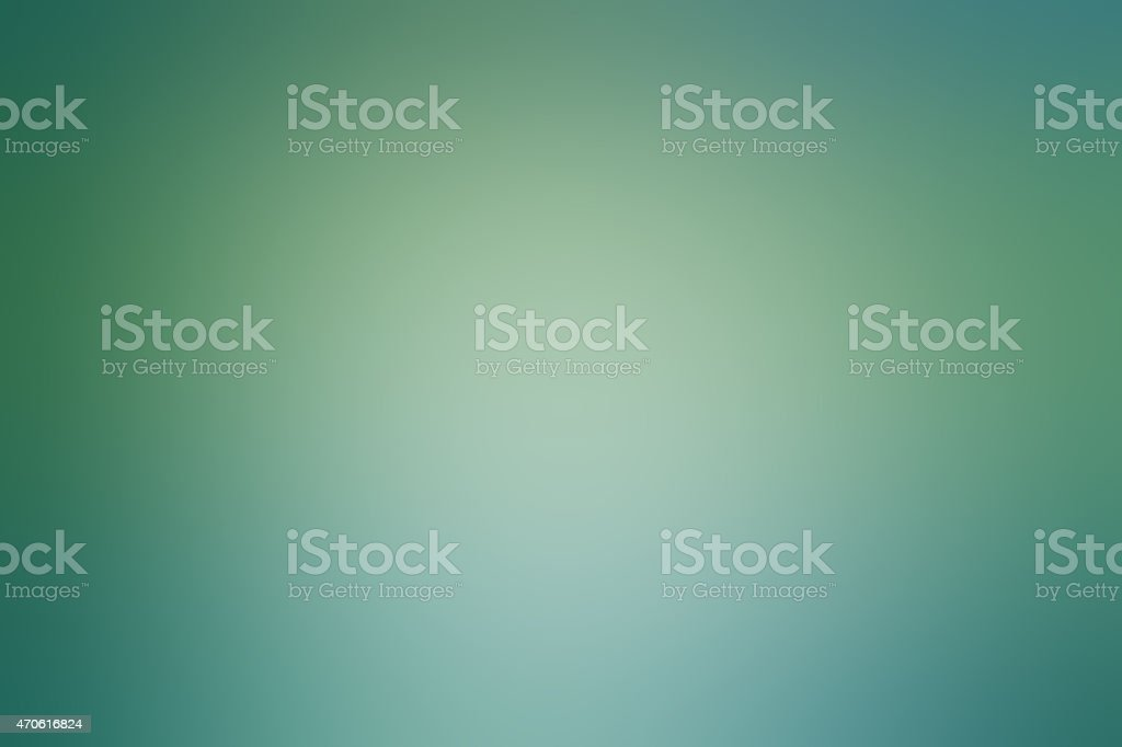 Abstract green blurred background in gradient stock photo