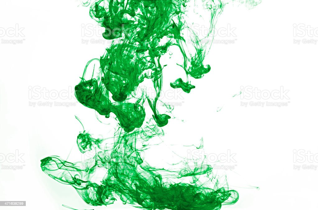 Abstract green ink in water with white background royalty-free stock photo
