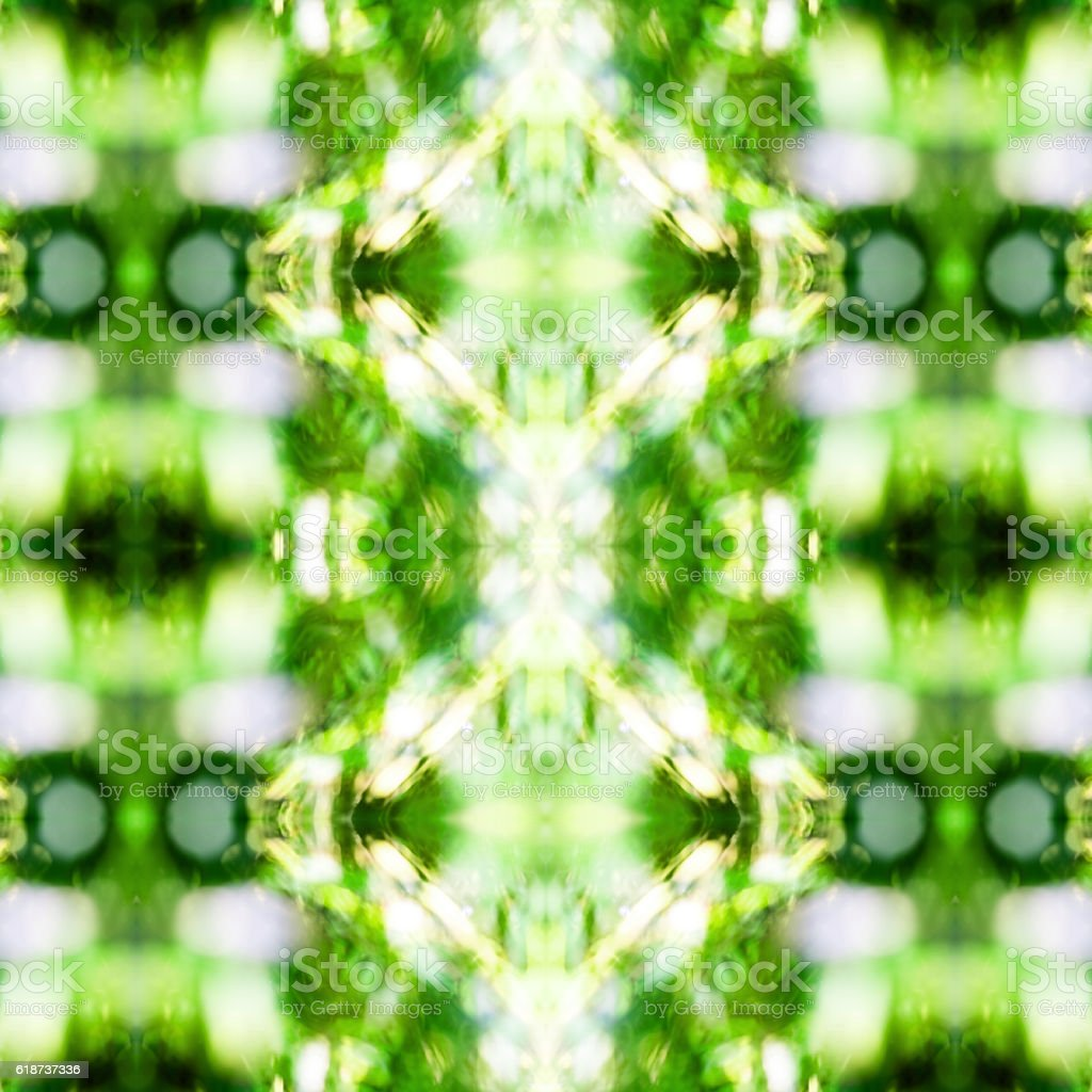 Abstract green nature bokeh background pattern surreal shaped symmetrical kaleidoscope stock photo