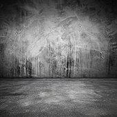 Abstract grungy interior with concrete floor and wall