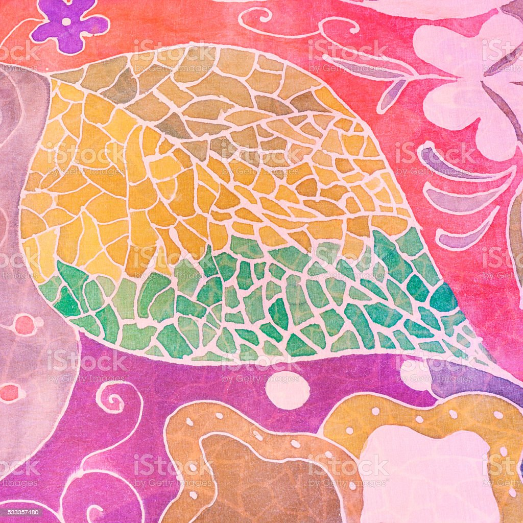 abstract hand painted leaf on pink silk batik stock photo