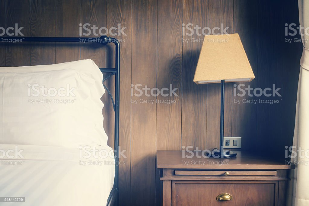 Abstract hotel bedroom with lamp and hotel bed stock photo