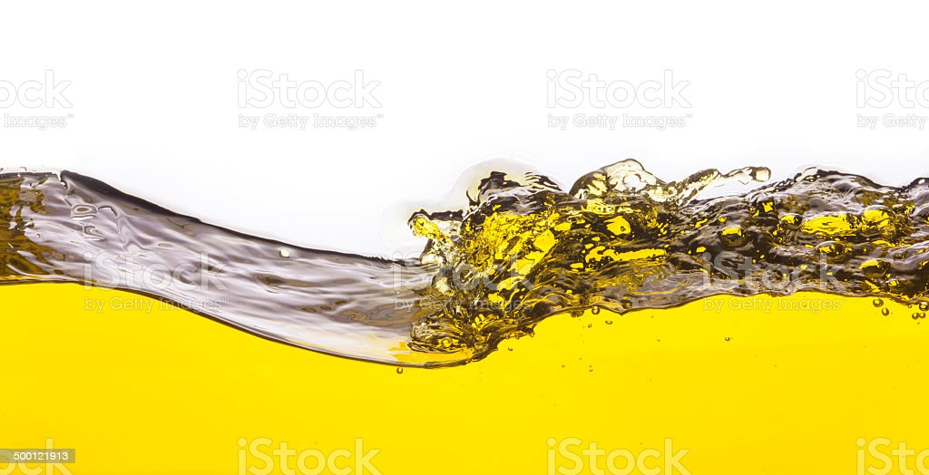 abstract image of a yellow liquid spilled. On a white background. royalty-free stock photo