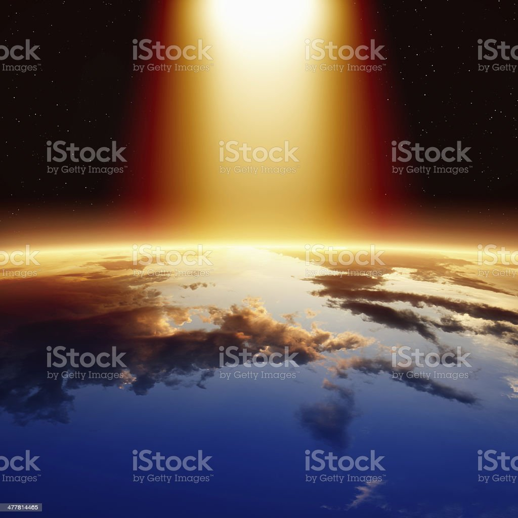 Abstract image of bright light over planet Earth stock photo