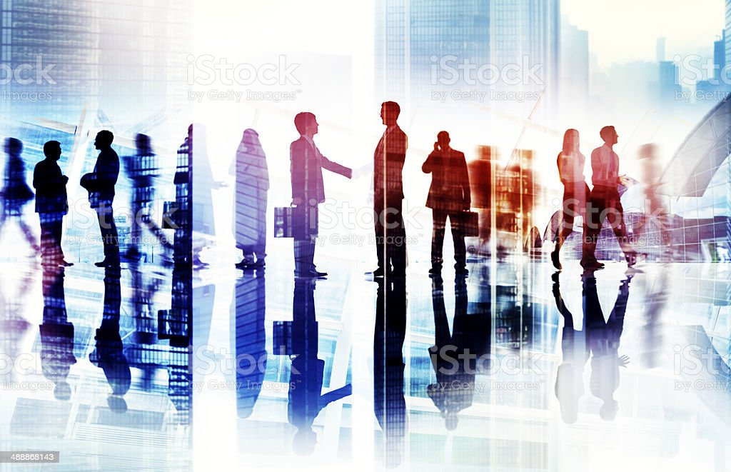 Abstract Image of Business Handshake in a Cityscape stock photo