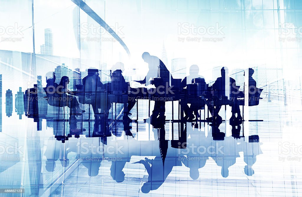 Abstract Image of Business People's Silhouettes in a Meeting stock photo